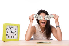 Laughing woman covering her eyes with money Royalty Free Stock Image