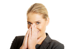 Laughing woman covering her mouth.  Royalty Free Stock Images
