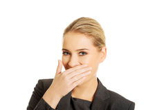 Laughing woman covering her mouth Stock Image