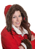 Laughing woman with crossed arms in a red winter coat Royalty Free Stock Images