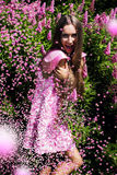 Laughing woman in dress with pink confetti Royalty Free Stock Photography