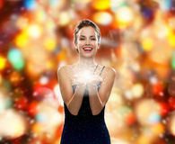 Laughing woman in evening dress holding something Stock Photo