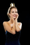 Laughing woman in evening dress wearing crown Stock Photography