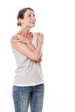 Laughing woman expressing delight wellbeing with body language Royalty Free Stock Photos