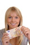 Laughing woman with fifty Euro Royalty Free Stock Photos