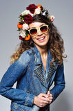 Laughing woman in flower crown wearing sunglasses Royalty Free Stock Photography