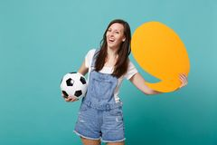 Laughing woman football fan cheer up support team with soccer ball, empty blank yellow Say cloud, speech bubble isolated. On blue turquoise background. People royalty free stock image