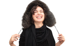 Laughing woman in fur ear-flapped hat Stock Photos