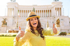 Laughing woman gives two thumbs up at Venice Square in Rome Royalty Free Stock Photos
