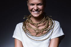 Laughing woman with golden necklace Stock Image
