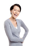 Laughing woman with hands on the hips Stock Image