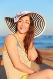 Laughing woman in hat on the beach Stock Photos