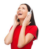Laughing woman with headphones Stock Photography