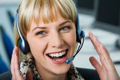 Laughing woman with headset Stock Images