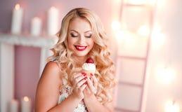 Laughing woman holding cake Stock Image