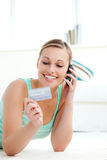 Laughing woman holding a card Stock Image