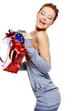 Laughing  woman holding the christmas boxes Royalty Free Stock Photo