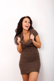 Laughing woman holding collar of dress Stock Photo