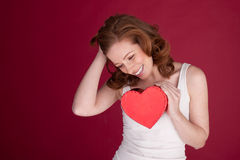 Laughing Woman Holding Heart Stock Image