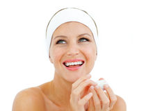Laughing woman holding a lip balm Royalty Free Stock Images