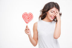 Laughing woman holding lollipop Stock Photography