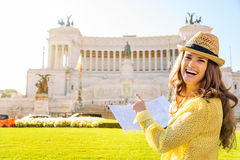 Laughing woman holding map of Rome pointing at Venice Square Stock Photos