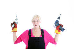Laughing woman holding a screwdriver and drill Royalty Free Stock Photo