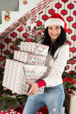 Laughing woman holding stack of Xmas presents Royalty Free Stock Photos