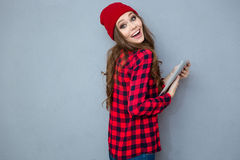 Laughing woman holding tablet computer Royalty Free Stock Images