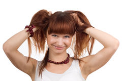 Laughing woman holding up hair Stock Photo