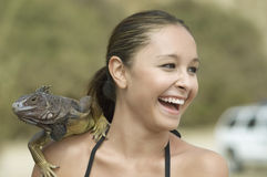 Laughing Woman With Iguana On Shoulder Royalty Free Stock Image