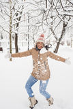 Laughing woman jumping in snow Royalty Free Stock Image