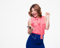 Laughing woman listening music in headphones Stock Images