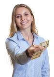 Laughing woman with long blond hair giving dollar  Royalty Free Stock Photo
