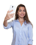 Laughing woman  with long dark hair loves selfies Stock Image