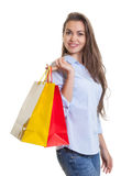 Laughing woman with long dark hair and shopping bags Stock Photos