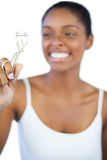 Laughing woman looking at her eyelash curler Stock Image
