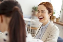 Laughing woman looking at her friend Royalty Free Stock Image