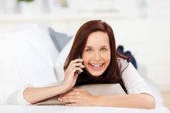 Laughing woman with a mobile Royalty Free Stock Photography