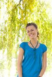 Laughing woman near willow. Laughing woman near yellow willow Royalty Free Stock Image