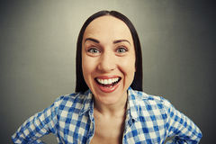 Laughing woman over grey background Stock Photos
