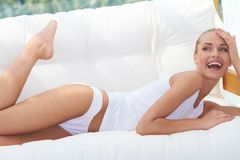Laughing woman in panties and shirt Stock Photography