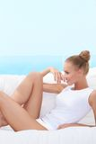 Laughing woman in panties and shirt Royalty Free Stock Image