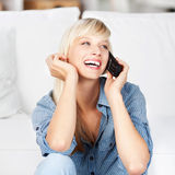Laughing woman on phone Royalty Free Stock Photos