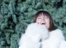 Laughing woman on the phone in winter coat Royalty Free Stock Photo