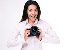 Laughing woman photographer with camera Royalty Free Stock Photos