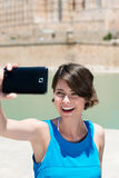 Laughing woman photographing herself Royalty Free Stock Photo