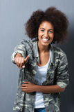 Laughing woman pointing at the camera Royalty Free Stock Photos