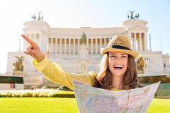 Laughing woman pointing while holding map at Venice Square Royalty Free Stock Photo
