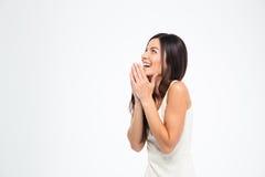 Laughing woman praying Royalty Free Stock Images